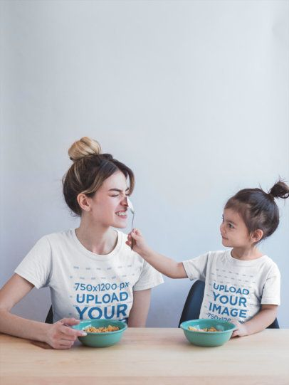 Mom and Daughter Wearing T-Shirts Mockup During a Fun Breakfast a20283