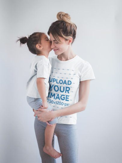 Woman Wearing a T-Shirt Mockup Being Kissed by her Daughter a20282