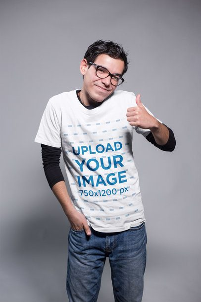Nerd Guy Being Nice Wearing a T-Shirt Mockup at a Photo Studio a19364