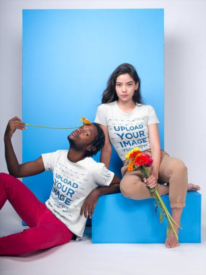 Mockup Featuring a Man and a Woman Wearing T-Shirts and Holding Flowers 19920