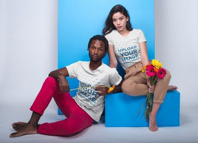 T-shirt Mockup of a Woman and a Man Posing With Flowers 19954