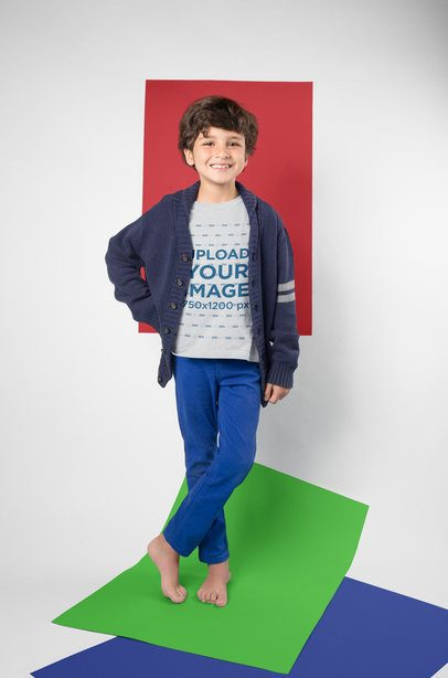Mockup of a Little Kid Posing Wearing a T-Shirt in a Photo Studio with Color Papers a19485