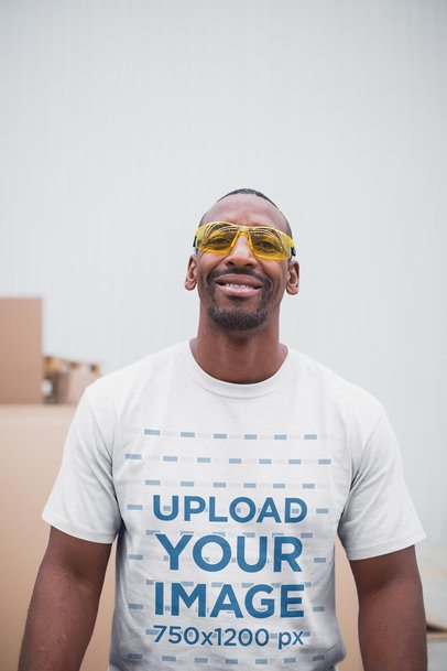 smiling warehouse worker wearing safety goggles and a t-shirt mockup a20449