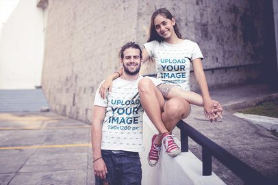 Smiling Couple Wearing T-Shirts Mockup in an Urban Environment a20588