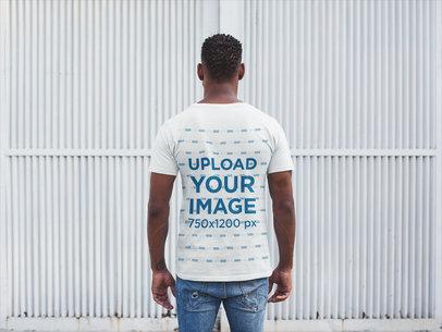 Back Shot Tshirt Mockup of a Man Facing a White Metal Door 20746