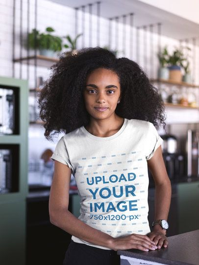 Mockup of a Woman with Curly Hair Wearing a T-Shirt at a Startup 20406