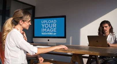 Girl Working with an iMac Mockup Near her Coworker a20982