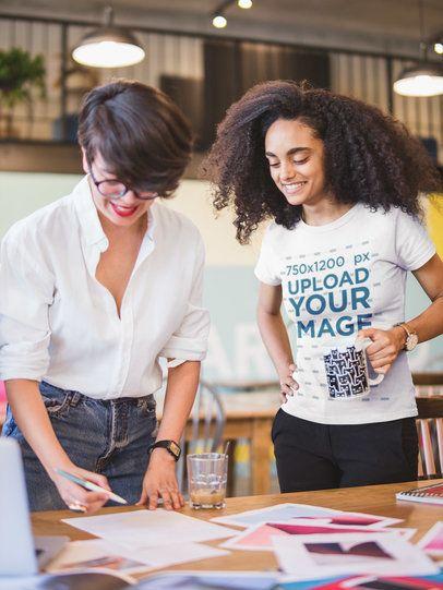 Woman Wearing a T-shirt Mockup Looking at a Mood Board 20435