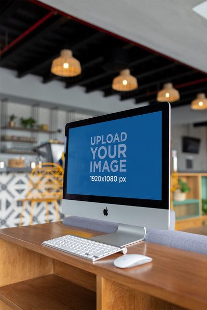 iMac Mockup Standing on a Wooden Surface a21171