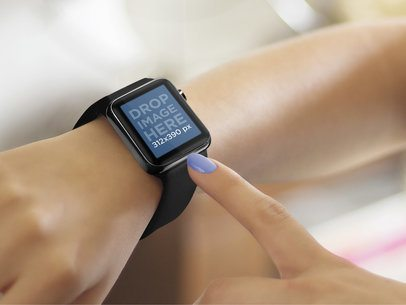 Close-up of Young Woman Using a Black Apple Watch on Her Wrist