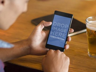 Android Mockup of Man Having a Beer and Using Sony Xperia