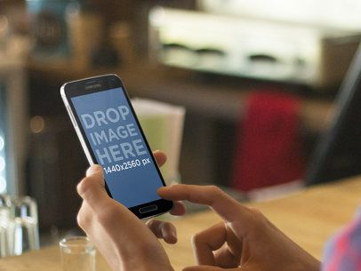 Mockup Template of Young Man Using an Android Smartphone at a Bar