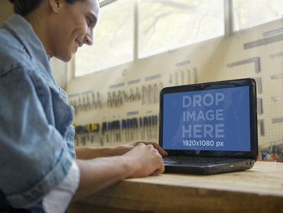 PC Mockup of Young Man Using his HP Laptop at an Industrial Workshop