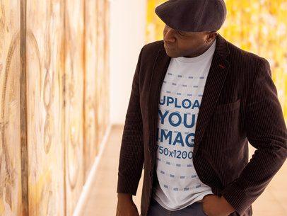 Tshirt Mockup of a Senior Man Wearing a Beret at an Art Exhibition 21467