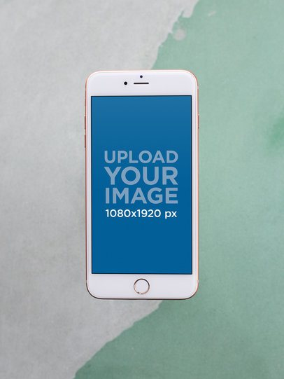 iPhone 7 Plus Mockup Against a Green and White Surface a21613