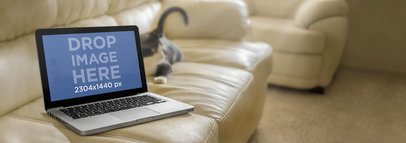 Mockup Template of a Macbook Pro on White Leather Couch