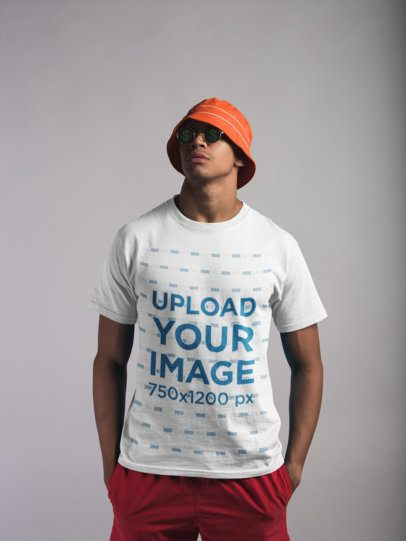 Mockup of a Man Wearing a Round Neck Tee and Beach Clothing 21081
