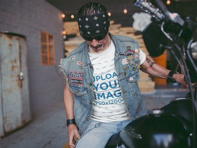 T-Shirt Mockup of a Man on a Motorcycle Wearing a Patched Denim Vest 20247