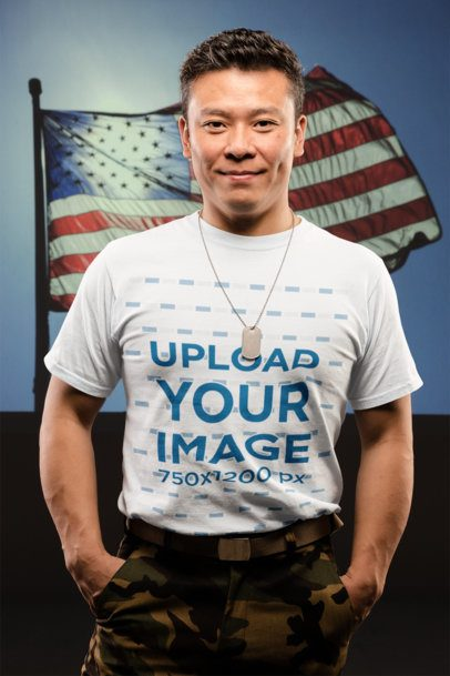 Mockup of a Proud American Soldier Wearing a T-Shirt in Front of the Flag 21252
