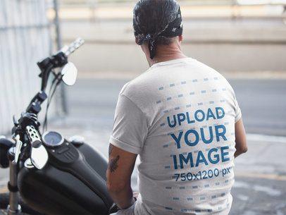 Backshot T-Shirt Mockup of a Biker Man Wearing a Bandana 20243