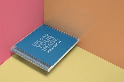 CD Album Mockup Floating Over a Corner 22012