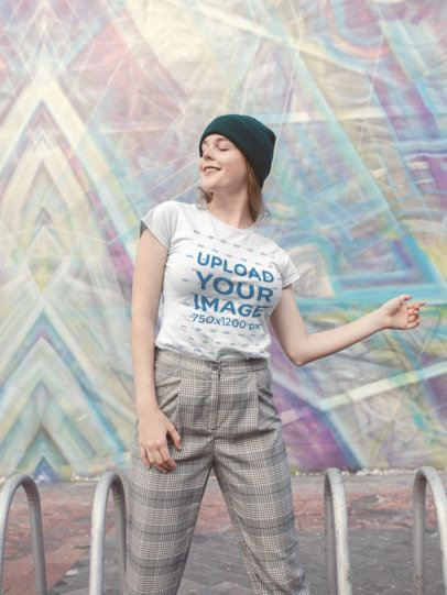 T-Shirt Mockup of a Woman Smiling in Front of Street Art 22671