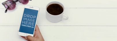 iPhone 6 Mockup of a Woman Using her iPhone at a Café a2705