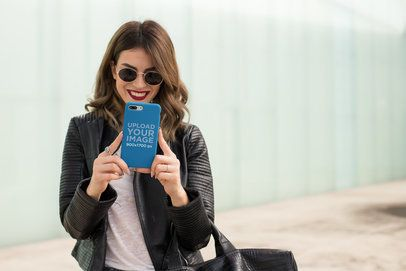 iPhone Case Mockup Featuring a Woman Smiling at Her Phone 22895