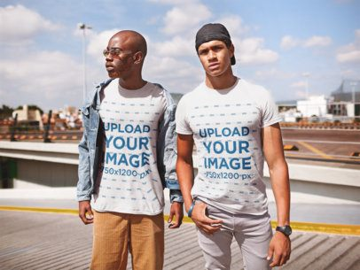 Mockup of Two Friends Wearing T-Shirts at a Parking Lot 22401