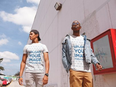 T-Shirt Mockup of Two Friends Walking Outside a Shopping Center 22408