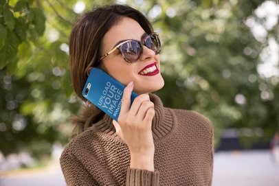 Mockup of an iPhone Case and a Woman Wearing a Brown Sweater 22910