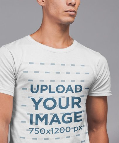 T-Shirt  Mockup of a Fit Young Man Against a Plain Background 21552