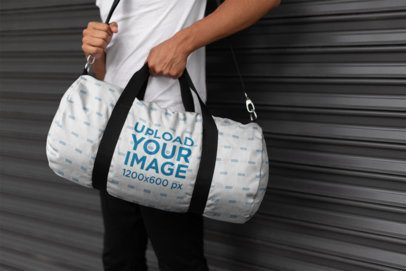 Mockup of a Man Holding a Kit Bag 23236