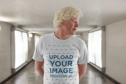 T Shirt Mockup of a Serious Man with Curly Hair in a Hallway 22235