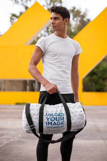 Mockup of a Serious Man Holding a Gym Bag Outdoors 23239