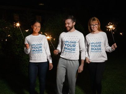 Christmas Sweater Mockup Featuring Three Friends Holding Sparklers 18045