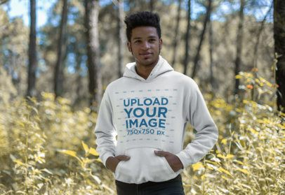 T-Shirt Mockup Featuring a Smiling Man Standing in the Countryside 23189