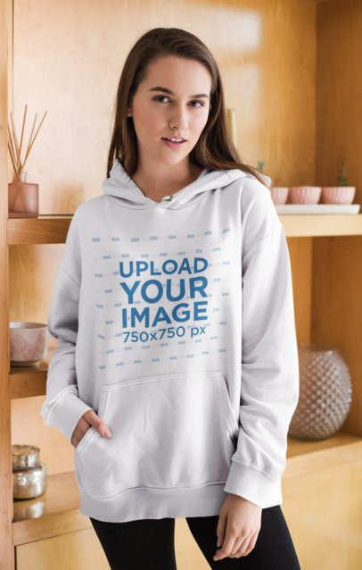 Mockup of a Beautiful Woman in a Cozy Pullover Hoodie at Home 23198