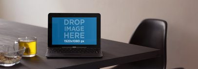 Laptop Mockup Featuring an Asus Laptop on Top of a Dinner Table a4788wide