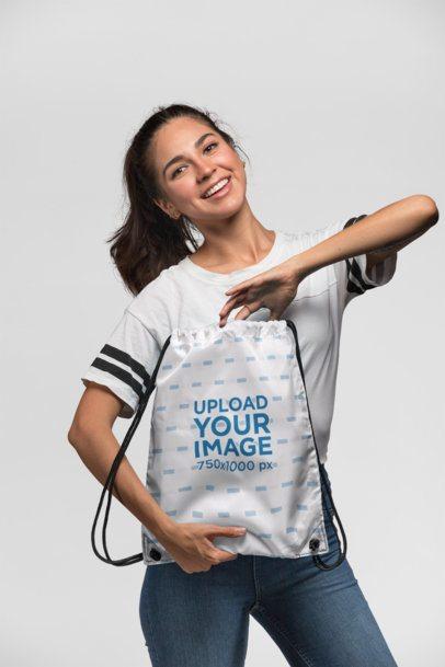 Drawstring Bag Mockup of a Happy Woman at a Studio 23664