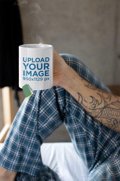 Mug Mockup Featuring a Tattooed Man in His Pajamas 24015