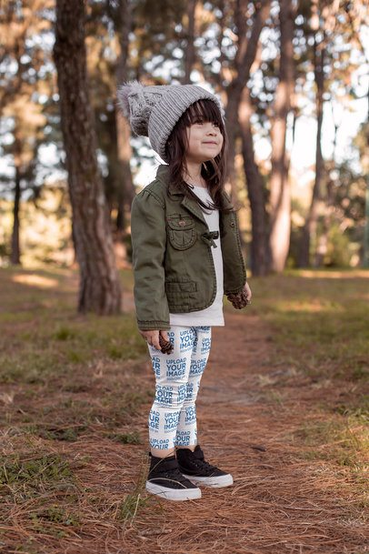 Leggings Mockup Featuring a Little Girl Holding a Pinecone in the Woods 23931