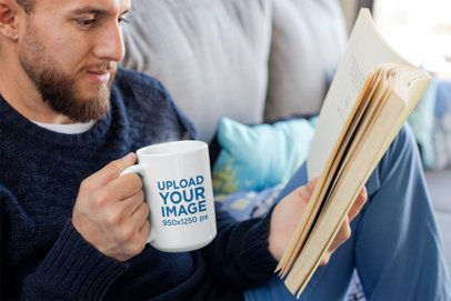 Mug Mockup of a Bearded Man Drinking Coffee and Reading a Book 24022