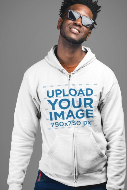 Mockup of a Trendy Man Wearing a Zip Up Hoodie in a Studio 24328
