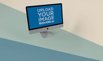 Mockup of an iMac Standing on a Tricolor Surface 24779