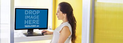 Desktop PC Mockup of a Pretty Lady at a Creative Office a5499