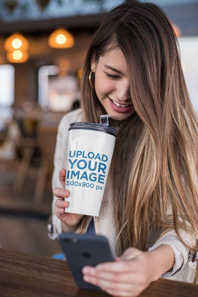 Travel Mug Mockup of a Smiling Girl Looking at Her Phone 24344