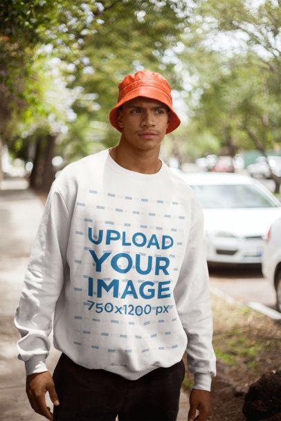 Mockup of a Man Wearing a Sweatshirt Walking in the Suburbs 21066