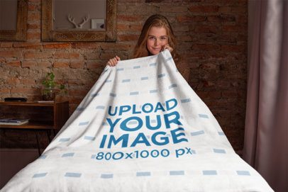 Throw Blanket Mockup Featuring a Girl Sitting on a Bed 24677
