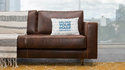 Parallax Video Mockup Featuring a Pillow on a Leather Couch 26018